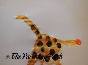 Painting an Orange Giraffe Eye