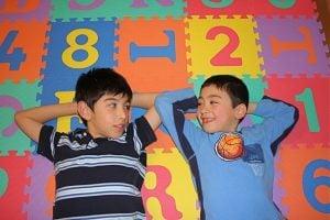 Brothers on Alphabet Mat