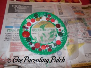 Buttons Glued on Green Paper Plate