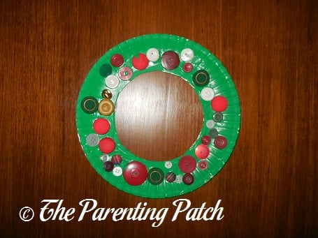 Buttons Glued on Green Paper Plate Paper Plate Button Christmas Wreath & Paper Plate Button Christmas Wreath Craft | Parenting Patch