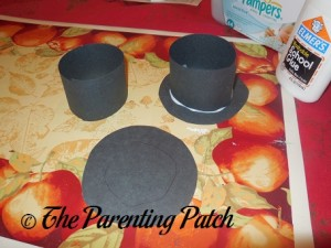 Gluing the Black Paper Hats