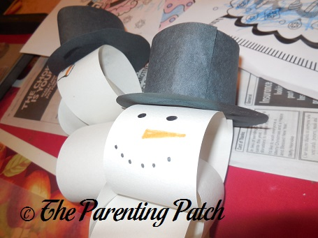 Gluing The Black Paper Hats To Chains Chain Snowmen