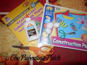 Construction Paper, Cotton Balls, Glue, and Scissors