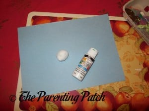 Blue Construction Paper, White Paint, and Cotton Ball