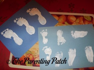 White Footprints on Blue Paper