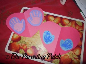 Gluing the Paper Mittens on Construction Paper Hearts