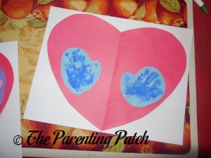 Gluing the Heart on White Paper