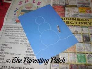 White Crayon Snowman Outline on Blue Paper