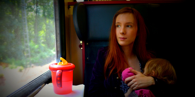 Woman Breastfeeding on Train
