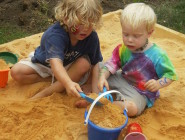 Boys Playing in Sandbox
