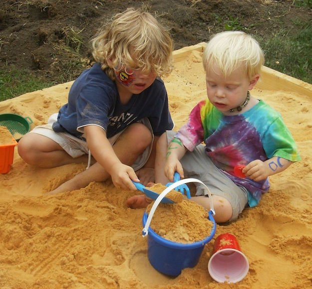 Boys Playing in Sandbox