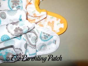 Hip Snaps of the of the Capri and Blueberry Mini Coverall Newborn Diaper Covers