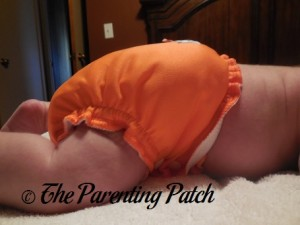 Side of Size 1 AppleCheeks Envelope Diaper Cover at Ten Pounds 2