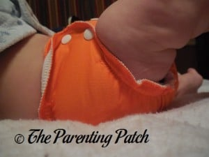 Side of Size 1 AppleCheeks Envelope Diaper Cover at Sixteen Pounds