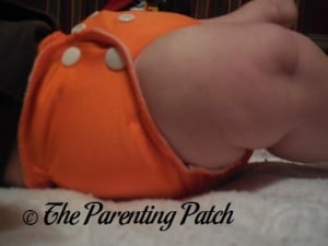 Side of Size 1 AppleCheeks Envelope Diaper Cover at Seventeen Pounds