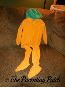 Orange Footed Pajamas and Green Fleece Hat
