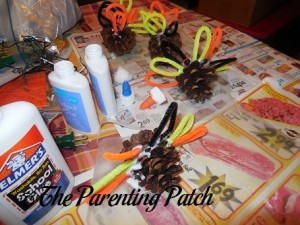 Gluing the Pipe Cleaner Ovals to the Pinecones