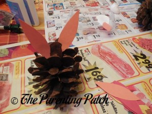 Gluing the Construction Paper Ovals to the Pinecone