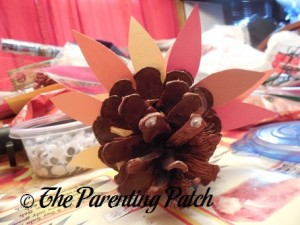 Gluing Small Wiggle Eyes to the Pinecone