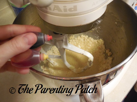 Adding Red and Yellow Food Coloring to the Butter and Egg Mixture -