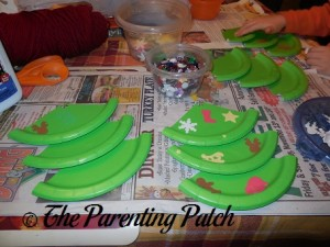Putting Foam Christmas Stickers on the Paper Plate Christmas Tree