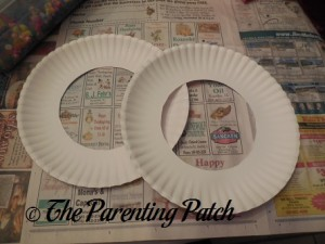 Cutting the Centers from the White Paper Plates