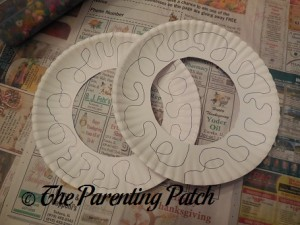 Drawing Wiggly Lines on the White Paper Plate Circles