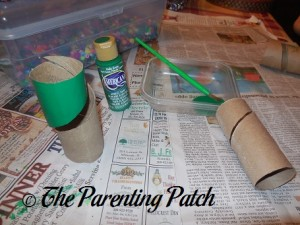 Painting the Toilet Paper Rolls Green