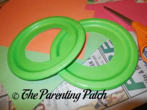 Cutting the Center Circles from the Green Paper Plates
