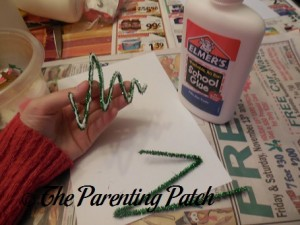 Spreading Glue on the Bent Green Pipe Cleaners