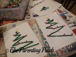 Decorating the Pipe Cleaner Trees with Beads