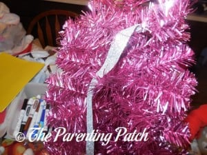 Decorating the Pink Christmas Tree with Silver Decorations 1