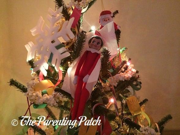 The Elf Sleeping in the Christmas Tree