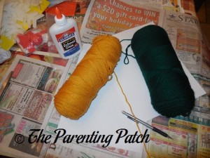White Paper and Yellow and Green Yarn