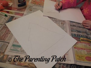 Drawing Christmas Tree Outlines on the White Paper