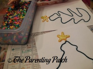 Filling the Yellow Star Outlines with Yellow Beads