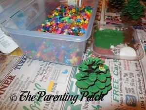 Gluing Beads to the Pinecones
