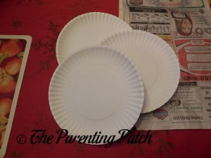 Three White Paper Plates