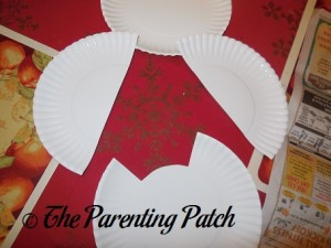 Cutting the Paper Plates for the Snowy Owl Craft
