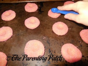 Pressing Indentations in the Gummy Bear Sugar Cookie Thumbprint Cookie Dough Balls