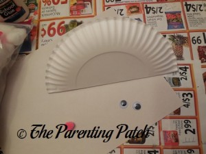 Folding a Paper Plate in Half for the Arctic Fox Paper Plate Craft