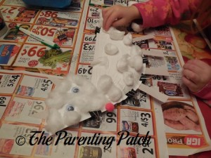 Adding Cotton Balls to the Arctic Fox Paper Plate Craft