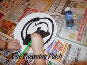 Painting the Paper Plate Black