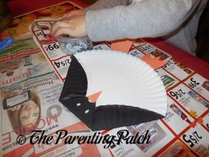Gluing Eyes on the Paper Plate Penguin Craft
