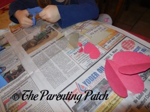 Cutting Hearts for Valentine's Day Heart Butterfly Craft