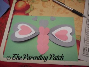 Gluing the Valentine's Day Heart Butterfly Craft