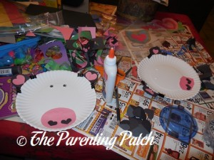 Gluing Pieces for Valentine's Day Paper Plate Cow Craft