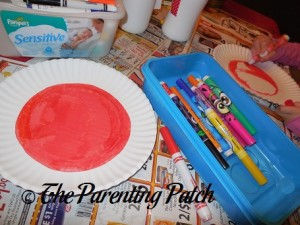 Coloring the Inside of the Paper Plate Red