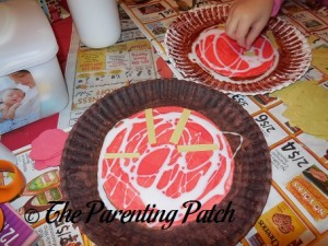 Gluing the Yellow Strips on the Paper Plate Pizza