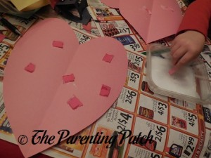 Gluing Torn Paper Pieces to the Pink Heart